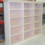 Shelving is added to this custom bookcase by BK Woodworking of Ann Arbor Michigan