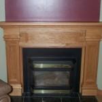 Custom fireplace mantel in oak, designed by BK Woodworking of Ann Arbor, Michigan