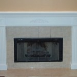 A custom custom fireplace surround designed by BK Woodworking of Ann Arbor, Michigan