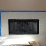 Fireplace area before BK Woodworking designed a custom fireplace surround for the bare space